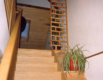 intégration d'escalier en bois avec aménagement de combles